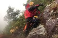 Rescue team members carry the injured woman up Kowloon Peak. Photo: Handout