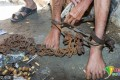 A man users wire cutters to free Xu from the shackles around his ankles. A hospital has agreed to assess his mental health state and provide a rehabilitation programme for him. Photo: Handout