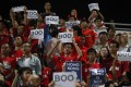 """Hong Kong fans hold up signs that read """"Boo"""" while the national anthem was being played back in 2015. More 'creative' responses to the new national anthem law are likely next October. Photo: AFP PHOTO"""