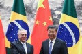 Chinese President Xi Jinping shakes hands with Brazilian President Michel Temer during a signing ceremony at the Great Hall of the People in Beijing. Photo: Reuters