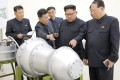 North Korean leader Kim Jong-un, second right, inspects what is purported to be a miniaturised hydrogen bomb in this undated photo released by North Korea's Korean Central News Agency on Sunday. Photo: Reuters