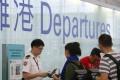 Passengers line up at the departure gates in Hong Kong International Airport. Photo: David Wong