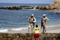 Mexican soldiers patrol Palmilla Beach where three men were killed by a group of men with automatic weapons in San Jose del Cabo. Photo: TNS