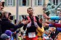 Frenchman Francois d'Haene finishes the UTMB in first place and is hailed an ecstatic home crowd. Photos: Hoka One One