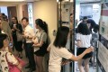 Anxious visa applicants and their families queued up at the British visa centre in Causeway Bay on Monday. Photo: Nora Tam