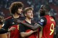 Belgium players celebrate after qualifying for the 2018 World Cup. Photo: Reuters