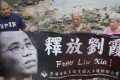 Hong Kong activists protesting for the release of Liu Xia, the wife of the Nobel Peace Prize winner Liu Xiaobo. Liu Xia is still living under house arrest in Beijing, even though she has not been convicted of any crime. The case has drawn widespread condemnation from governments and rights groups around the world. Photo: EPA