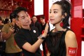 Celebrities including Shu Qi, Kary Ng and Janet Ma entered the red Armani Box and tried out the latest make-up products