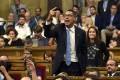 Popular Party PP spokesman Xavier Garcia Albiol protests from his seat. Photo: AFP