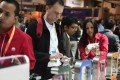 Customers try out Huawei Honor 6 Plus and Honor P7 smartphones. Photo: AFP