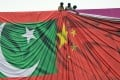 Workers arrange a banner featuring the Chinese and Pakistani flags ahead of a visit to Islamabad by China's President Xi Jinping in 2015. Pakistan's Foreign Minister Khawaja Asif is expected to arrive in Beijing on Friday. Photo: AFP