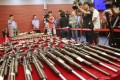 Officers in Guangdong display some of the modified firearms that were sold in more than 20 mainland cities. Photo: ChinaFotoPress