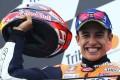 Marc Marquez celebrates on the podium after winning the San Marino MotoGP. Photo: AFP