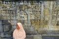 A woman visits the Buddhist temple of Borobudur. Photo: Alamy