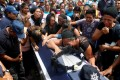 Relatives mourn on top of the coffin of police officer Juan Jimenez, who was a victim of the earthquake that struck the southern coast of Mexico late on Thursday, during his burial in Juchitan on Sunday. Photo: Reuters