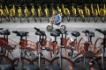 A child rides a bicycle past others from bike-sharing companies parked along a sidewalk in Beijing . (AP Photo/Andy Wong)