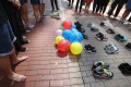 Shoes were placed on the ground in Mong Kok's pedestrian area to imitate New Zealand's protest where activists used 606 pairs of shoes to represent the number of suicides in New Zealand in first half of 2017. Photo: Felix Wong