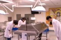 """A scene from an anatomy class, in which medical students show respect to their """"silent teacher"""", from the Taiwanese documentary film The Silent Teacher."""