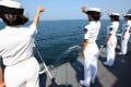 Chinese officers wave goodbye to the Russian fleet at the end of a joint naval drill off Guangdong in September last year. Photo: Xinhua