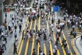 Shoppers crossing Queen's Road Central in Central Hong Kong. Photo: Sam Tsang