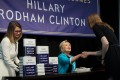 Hillary Clinton signs copies of her new book. Photo: AFP