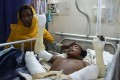 Rohingya Muslim refugee Rashida Begum stands next to her son Azizul Hoque, 15, as he is treated after being injured by a landmine while crossing from Myanmar to Bangladesh, at a hospital in Cox's Bazar. Photo: AFP