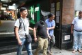 One of the three suspects being escorted outside Mirador Mansion in Tsim Sha Tsui on Thursday. Photo: Handout