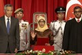 President-elect Halimah Yacob takes the oath of office. Photo: EPA