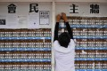 """Posters advocating Hong Kong independence are put up on Chinese University's """"democracy wall"""", on September 7. Photo: AFP"""