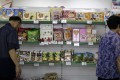 Shoppers browse local and Chinese snacks on sale at the Potonggang department store in Pyongyang in June. Photo: AP
