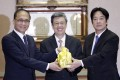Taiwan's former Premier Lin Chuan (left), Vice-President Chen Chien-jen (centre) and new Premier William Lai pose for a photograph during a handover ceremony in Taipei on Friday. Photo: EPA