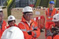 Federick Ma(middle) at a major station which forms part of London's Crossrail project, which the MTR will run when it completes. Photo: Denise Tsang