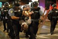 Police officers arrest a man during protests in St Louis. Photo: TNS
