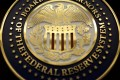 Tuesday's Fed meeting will be a key focus of the market and drive yuan renminbimovement, analysts said. Photo: Reuters