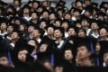 A graduation ceremony at Fudan University in Shanghai. Graduates from Hong Kong and the rest of China need to reject a world divided by ideology, race, wealth and extremism. Photo: Reuters