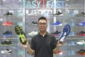 Dr Jason Cheung at a shoe shop on Fa Yuen Street, also known as Sneaker Street, in Mong Kok. Photo: Jonathan Wong