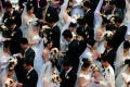 A mass marriage ceremony in Shanghai. The Chinese authorities are keen to promote marriage as a 'core socialist value'. Photo: AP