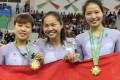 Sarah Lee Wai-sze is flanked by Li Yin-yin (left) and Vivian Ma Wing-yu after winning gold in the women's team sprint at the Asian Indoor Games in Ashgabat. Photos: Hong Kong Olympic Committee