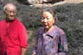 Pan Yuanju stands with her husband Guo Shuming. The 68-year-old spent a week in hospital after foiling the attempted theft of an ancient relic in southwestern China's Sichuan province. Photo: Handout