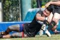 Valley's Taumafi Komiti puts the heat on his Tigers opponent. Photos: HKRU