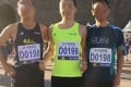 The photo of three runners with the same registration number at the Beijing Marathon last Sunday which was posted on social media. Photo: Handout