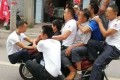 The owner of a scooter shop in Sichuan province was fined for organising and taking part in a dangerous stunt to promote the durability of his bikes. Photo: Handout