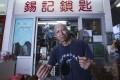 Locksmith Cheng Shek-yu outside his shop at Shun Tin Estate. Photo: K. Y. Cheng