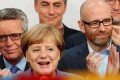German Chancellor Angela Merkel and members of her ruling coalition react after winning the German general election on Sunday in Berlin. Photo: Reuters