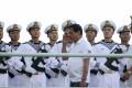 Filipino President Rodrigo Duterte salutes Chinese sailors during a goodwill visit earlier this year. Photo: EPA