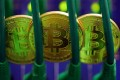 Bitcoins sit among Ethernet cables in this file photo. Despite its crackdown on bitcoin exchanges and initial coin offerings, China remains interested in grasping the underlying blockchain technology and creating its own sovereign digital currency. Photo: Bloomberg