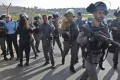Israeli border police and police gather at the scene of an attack at the entrance to the West Bank settlement of Har Adar after a Palestinian opened fire on security personnel before being shot dead on Tuesday. Photo: AFP