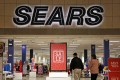 Shoppers walk into a Sears store in Pittsburgh. Department stores may bestruggling to draw customers, but they have not relinquished their hold on America's malls. Photo: AP