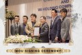 'Broken Tooth' Wan kuok-koi is seen at the signing ceremony with a number of executives. Photo: Handout