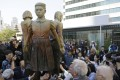 """People surround the """"comfort women"""" monument in San Francisco. Photo: AP"""